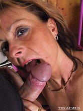 Mature cunt taking on a hard throbbing cock