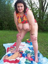 fat mature posing outside