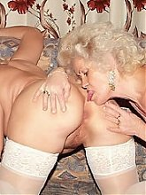 Francesca and Erlene are stocking clad older vixens licking holes and toying their cunts with a dildo