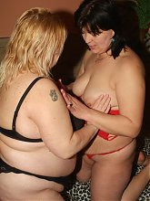 Mature fat women Rosalie and Lisa play with tits and pussies in this hot girl on girl porn