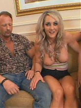 Busty blonde wife Lori Lust goes for a raunchy threesome with her fuck buddies while her husband is watching