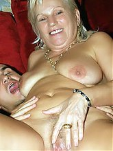 Sexy grandma Remy sucking off a younger dude and spreading her fat thighs for live sex show