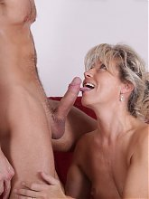 Nela is a blonde haired mature putting on a show on webcam and doggy fucked on the couch